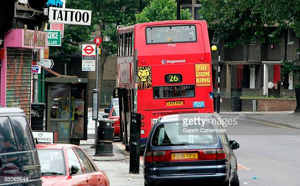 The number 26 bus which was stopped on its route down Hackney Road in Bethnal Green is seen on July 21 2005 in London England The windows were blown...