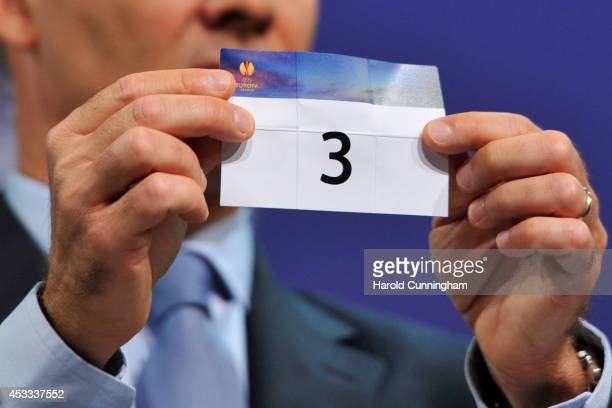 The number 3 is drawn during the 2014/15 UEFA Europa League Playoff round draw at the UEFA headquarters The House of European Football on August 8...