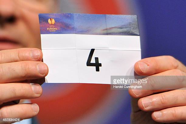 The number 4 is drawn during the UEFA 2014/15 Europa League third qualifying rounds draw at the UEFA headquarters The House of European Football on...