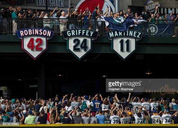 The number belonging to former and current hitting coach Edgar Martinez is unveiled next to Jackie Robinson's number and Ken Griffey Jr's number...
