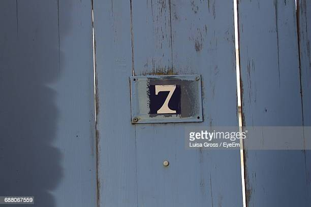 The Number Seven On A Plank Of Wood