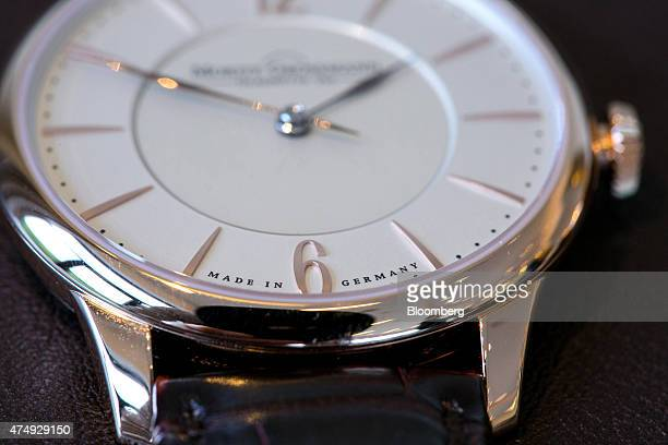 The number six and a 'Made In Germany' sign sit on the dial face of a Tefnut rose gold luxury wristwatch following manufacture at Moritz Grossmann...