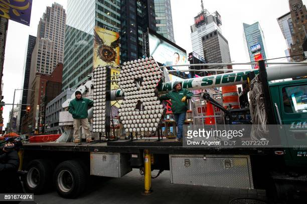 The numerals 1 and 8 arrive on a flatbed truck in Times Square ahead of the New Year's Eve celebration December 13 2017 in New York City The '18'...
