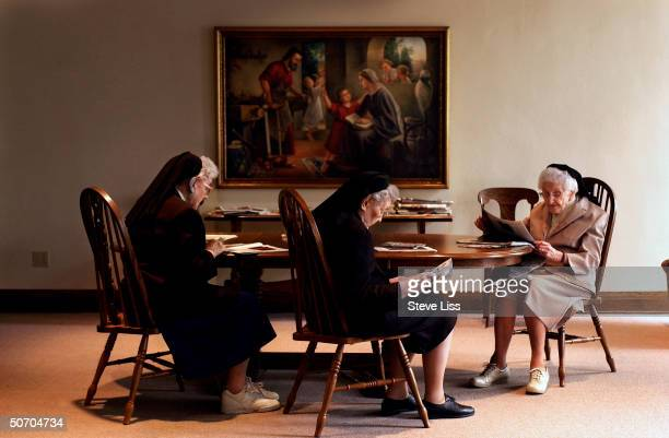 The Nun Study subjects Sisters Alcantara Claverine and Nicolette reading in the Community Room in at the School Sisters of Notre Dame convent where...