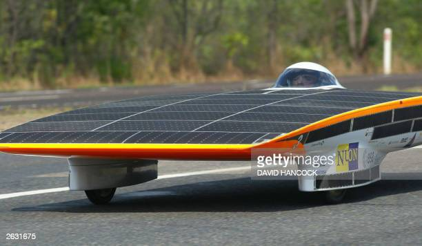 """The """"Nuna II"""" solar car, from Nuon Solar Team of Netherlands, heads from Darwin towards Adelaide in the World Solar Challenge, 19 October, 2003. AFP..."""