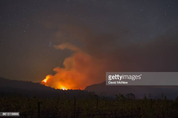 The Nuns Fire burns through the nightÊon October 14, 2017 close to Kenwood, near Santa Rosa, California. At least 40 people are confirmed dead with...