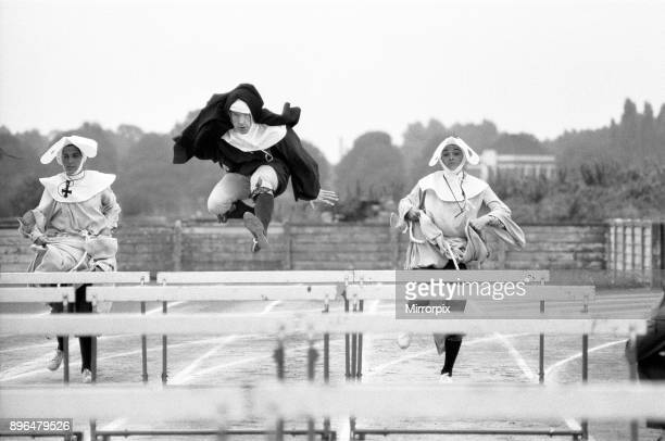 The Nun's Olympics Left to right Barbara Bremel Kevin Moran and Susan Crosland during filming at Chiswick Polytechnic sports ground 4th September 1972