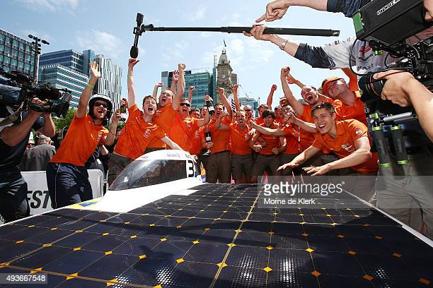 The Nuon Solar Team of the Netherlands celebrates after winning the 2015 Bridgestone World Solar Challenge at Victoria Square on October 22, 2015 in...