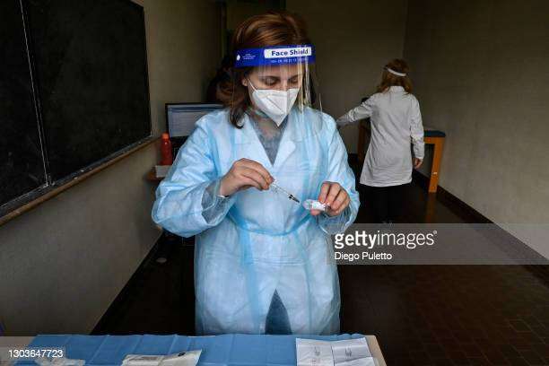 The nurse prepares the first doses of the Pfizer-BioNTech COVID-19 vaccine in the Moncalieri hospital on February 23, 2021 in Turin, Italy. The main...
