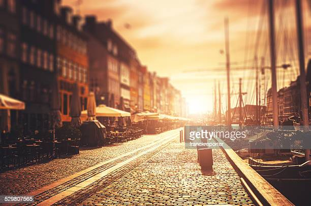 the nyhavn harbour at sunrise in copenhagen - nyhavn stock pictures, royalty-free photos & images