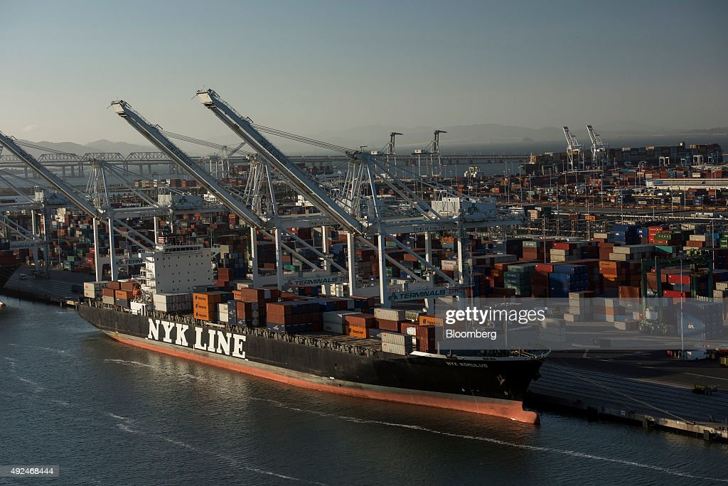 The NYK Romulus container ship, operated by Nippon Yusen Kaisha Line China Co. Ltd., sits docked at the Port of Oakland in this aerial photograph taken above Oakland, California, U.S., on Monday, Oct. 5, 2015. With tech workers flooding San Francisco, one-bedroom apartment rents have climbed to $3,500 a month, more than in any other U.S. city. Photographer: David Paul Morris/Bloomberg via Getty Images