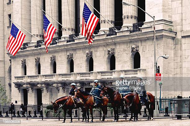 The NYPD, providing security for the New York Stock Exchange during an OWS protest march.