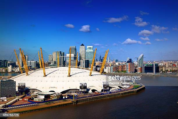 The O2 arena in North Greenwich district , River Thames, Skyscrapers of Canary Wharf - major business district at Eats London, skyscrapers of The...