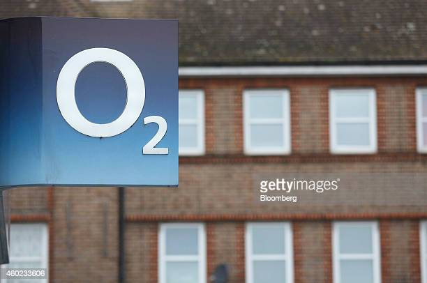 The O2 logo sits on display outside a mobile phone store operated by Telefonica SA in London UK on Tuesday Dec 9 2014 BT Group Plc is leaning toward...