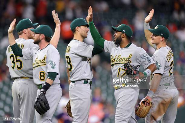 The Oakland Athletics celebrate after defeating the Houston Astros 6-2 at Minute Maid Park on April 09, 2021 in Houston, Texas.