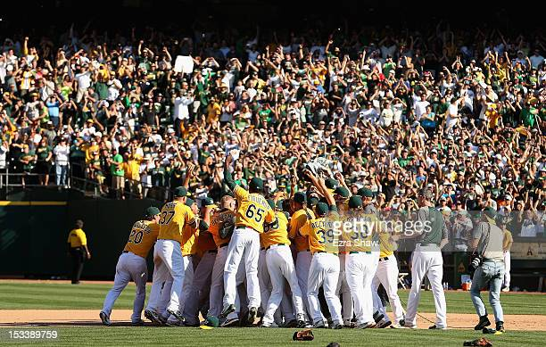 The Oakland Athletics celebrate after they beat the Texas Rangers to win the American League West Division Title at Oco Coliseum on October 3 2012 in...