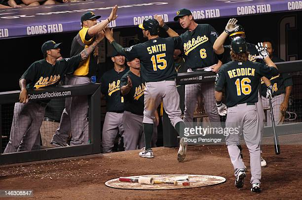 The Oakland Athletics celebrate as Seth Smith of the Oakland Athletics and Josh Reddick of the Oakland Athletics scored on the game winning two RBI...