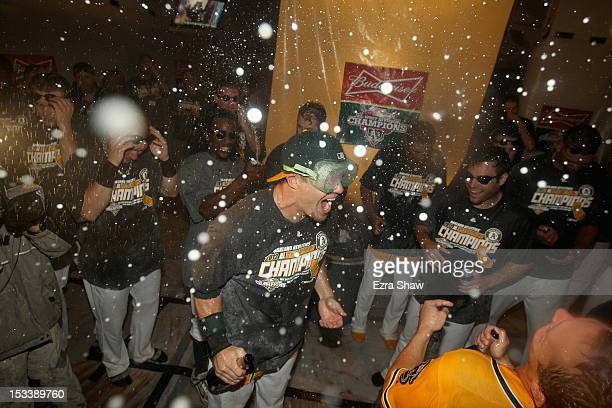 The Oakland Athletics celebrate in the locker room after they beat the Texas Rangers to win the American League West Division Title at Oco Coliseum...