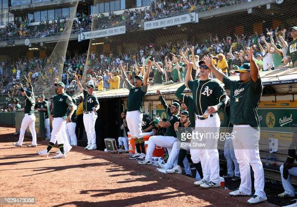 The Oakland Athletics dugout celebrates after Matt Olson hit a home run in the eighth inning to give them the lead over the Texas Rangers at Oakland...