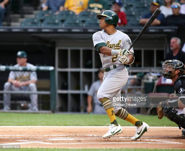 The Oakland Athletics' Khris Davis watches the flight of his tworun home run against the Chicago White Sox at Guaranteed Rate Field in Chicago on...