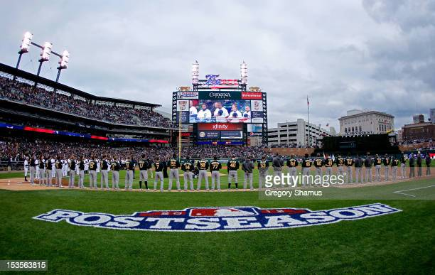 The Oakland Athletics line up on the baseline during pregame festivities and for the performance of the National Anthem prior to playing against the...