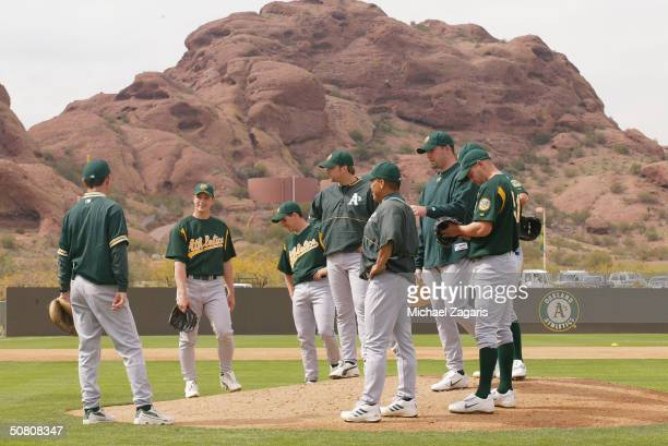 The Oakland Athletics pitchers gather at the mound to practice pitching drills during Spring Training at Phoenix Municipal Stadium on March 1 2004 in...