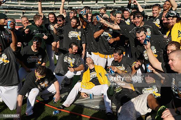 The Oakland Athletics pose for a team photo after they beat the Texas Rangers to win the American League West Division title at Oco Coliseum on...