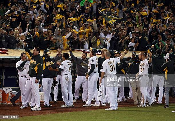 The Oakland Athletics wave to the crowd after they lost to the Detroit Tigers in Game Five of the American League Division Series at OaklandAlameda...