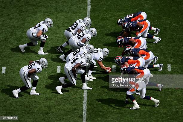 The Oakland Raiders and the Denver Broncos line up as the Raiders prepare to punt as the Denver Broncos defeated the Oakland Raiders 2320 in overtime...