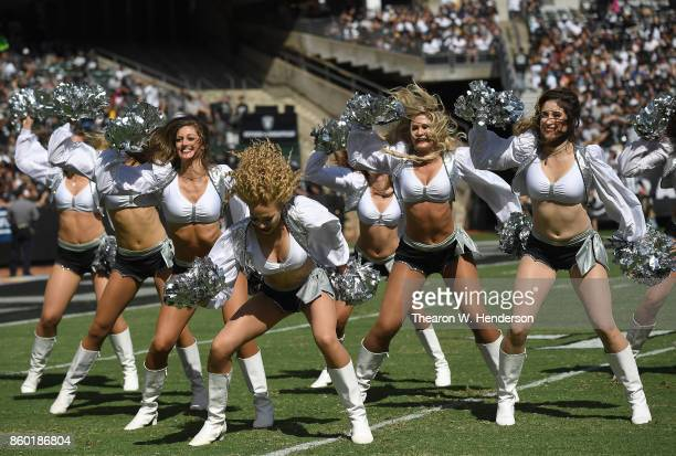 The Oakland Raiders cheerleaders the Raiderettes perform during an NFL football game against the Baltimore Ravens at OaklandAlameda County Coliseum...