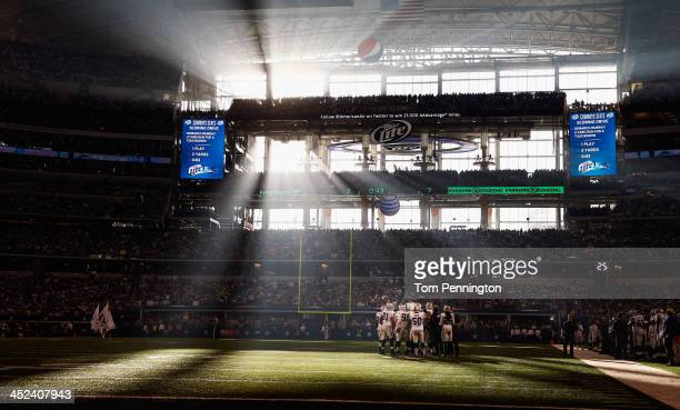 the Oakland Raiders huddle up against the Dallas Cowboys during a Thanksgiving Day game at ATT Stadium on November 28 2013 in Arlington Texas