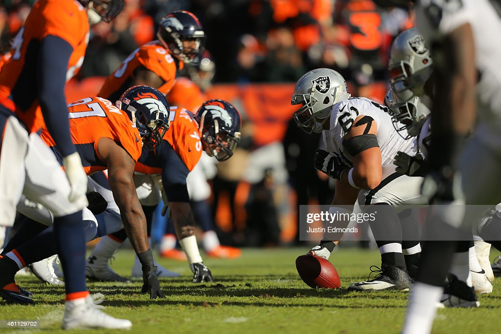 The Oakland Raiders offense lines up against the Denver Broncos defense at Sports Authority Field at Mile High on December 28, 2014 in Denver, Colorado.