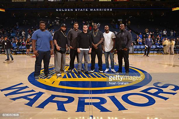 The Oakland Raiders pose for a group photo after the Indiana Pacers game against the Golden State Warriors on December 5, 2016 at ORACLE Arena in...