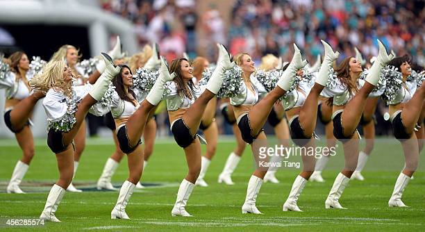 The Oakland Raiders Raiderettes perform at the NFL football match between Oakland Raiders v Miami Dolphins at Wembley Stadium on September 28 2014 in...