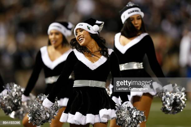The Oakland Raiders Raiderettes perform during the NFL game against the Dallas Cowboys at OaklandAlameda County Coliseum on December 17 2017 in...