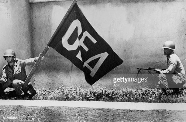 The OAS flag is held by Brazilian army man near National Palace in Santo Domingo in Dominican Republic - OAS forces moved to positions outside palace...