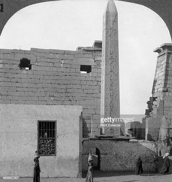 'The obelisk of Rameses II and front of Luxor Temple Thebes Egypt' 1905 'This obelisk before us like the temple pylon was erected by Rameses II Its...