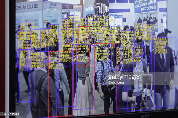 The object detection and tracking technology developed by SenseTime Group Ltd is displayed on a screen at the Artificial Intelligence Exhibition...