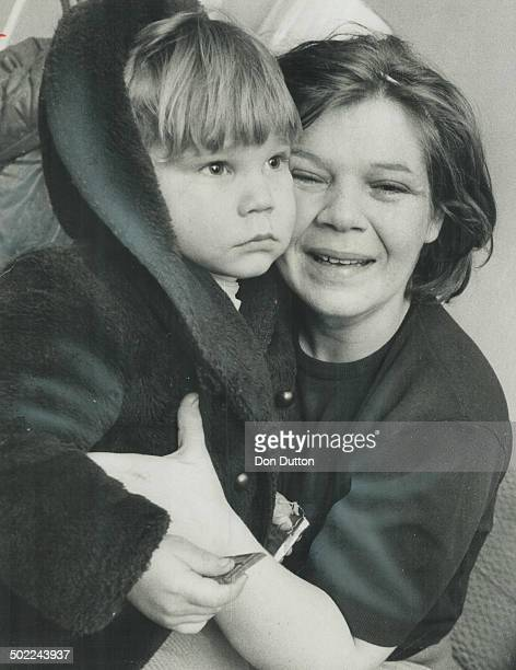 The object of a search by 250 policemen and volunteers 3yearold John Hachey clutches his mother Shirley Hachey after he was found in a restaurant...