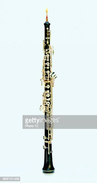 The oboe is a woodwind instrument of conical bore its mouthpiece having a double reed