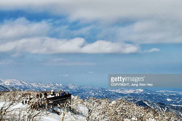 The observation deck on the mountain covered by white snow