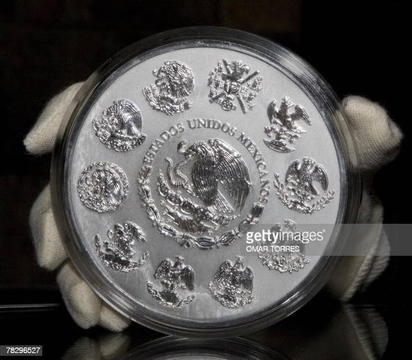 Calendario Ua.The Obverse Of Commemorative Silver Coin Calendario Azteca With