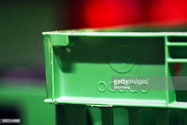 The Ocado company logo sits on the side of a crate at the Ocado Group Plc distribution centre in Dordon UK on Friday Dec 16 2016 Ocado provides home...