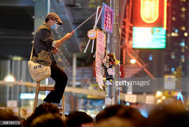 The Occupy Central illegal protestors are wearing facial masks to elude the future legal liability on 31th October 2014 in Hongkong China