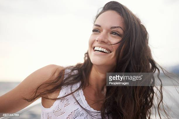 the ocean breeze is so rejuvenating - brown hair stock pictures, royalty-free photos & images