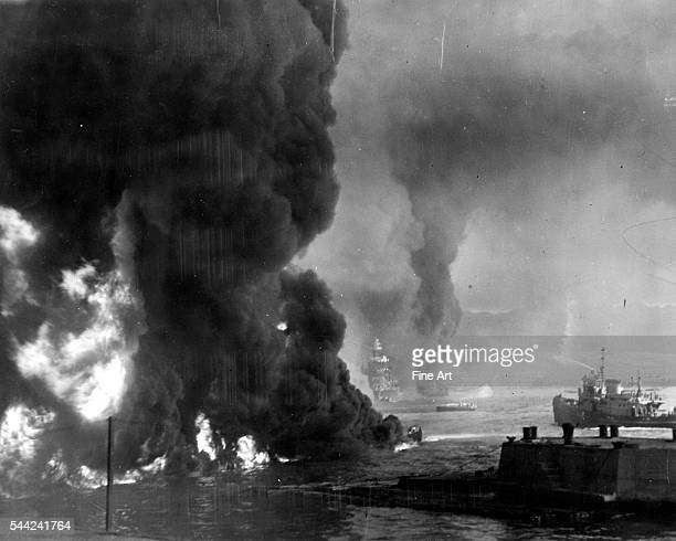 The ocean burns from oil near the Naval Air Station shortly after the Japanese attack on Pearl Harbor Hawaii December 7 1941 Silver print Navy...