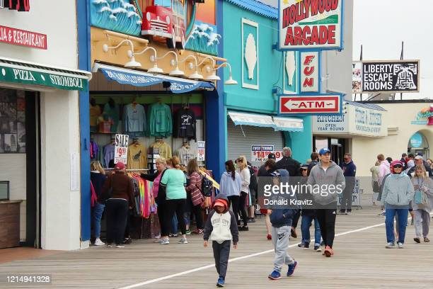 The Ocean City boardwalk is open for Memorial Day weekend with many visitors taking advantage during the coronavirus pandemic on May 24, 2020 in...
