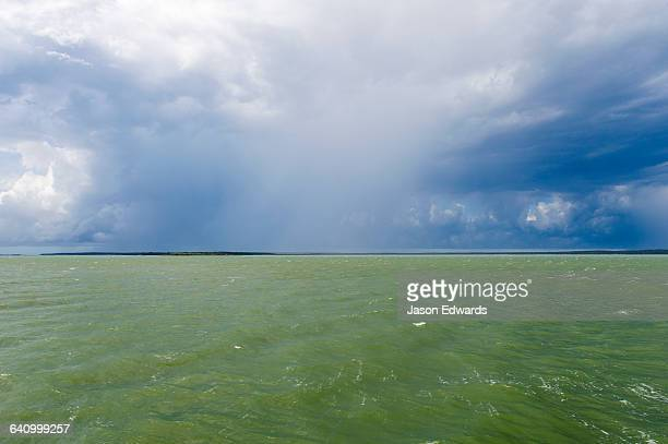 The ocean surface turns green during a tropical storm.