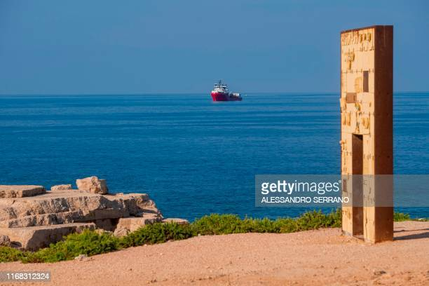 The Ocean Viking rescue ship sails off the coast of the island of Lampedusa in the Mediterranean Sea on September 15 with in foreground the Porta di...