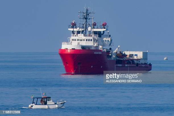 TOPSHOT The Ocean Viking rescue ship sails off the coast of the island of Lampedusa in the Mediterranean Sea on September 15 with in foreground the...